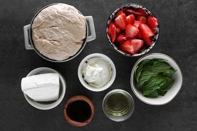 Ingredients for strawberry balsamic brie pizza