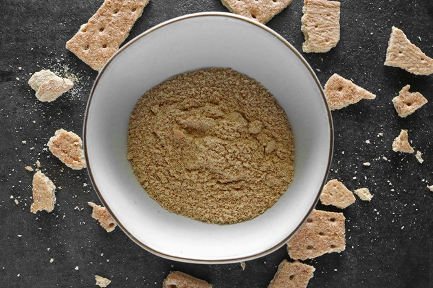 Crush graham crackers into crumbs