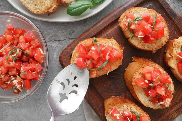Spoon tomatoes onto the bread