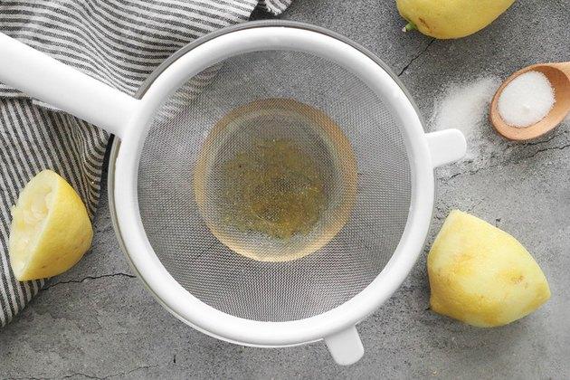 Strain lemon syrup