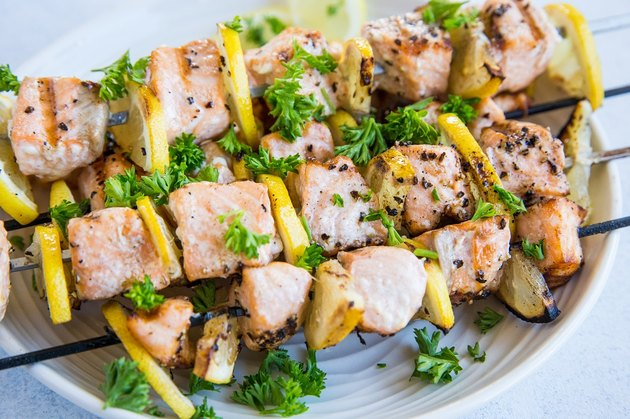 salmon skewers on a plate