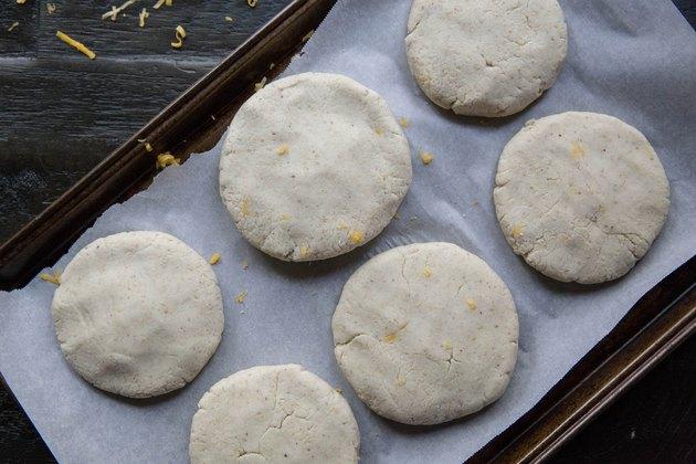 raw papusas on a baking sheet