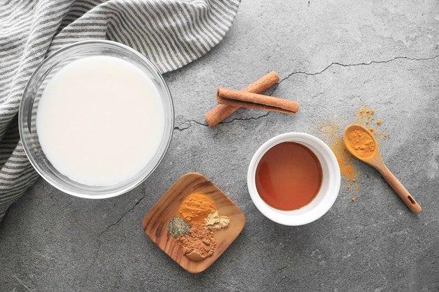 Ingredients for golden milk turmeric latte