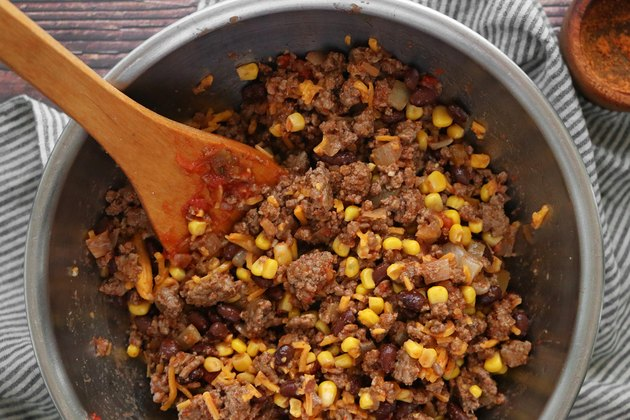 Mix ground beef with beans and corn