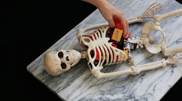 Placing candy inside skeleton