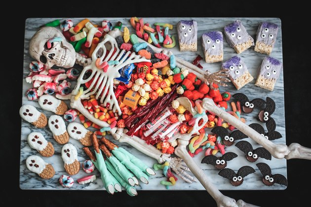 Skeleton party platter with candy and desserts