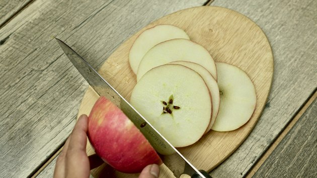 Slicing apples for Pumpkin Pie Punch Recipe