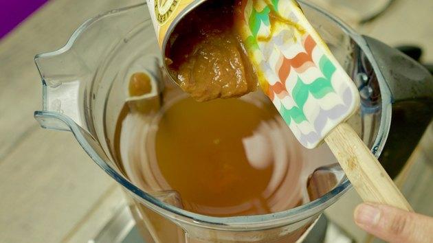 Adding pumpkin pie filling to blender for Pumpkin Pie Punch Recipe