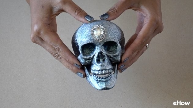 Gluing pear-cut gemstone applique to skull