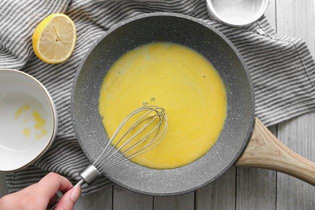 Whisk together egg yolks and lemon juice