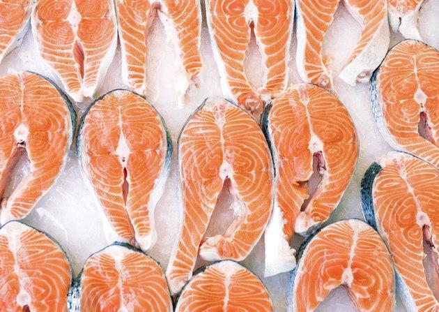 salmon slices on ice