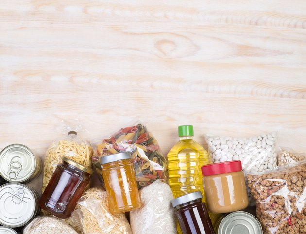 Food donations on wooden background