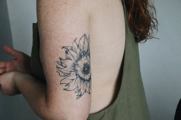 Young female arm with tattoo