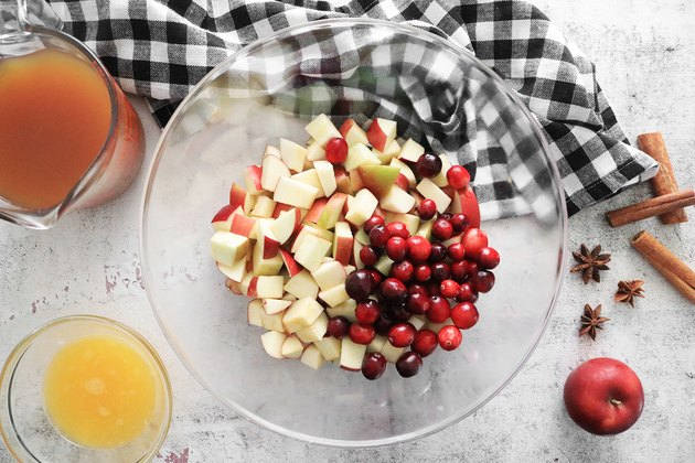 Combine apples and cranberries