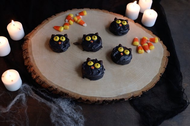 DIY chocolate-dipped Oreo cookies decorated to look like black cats