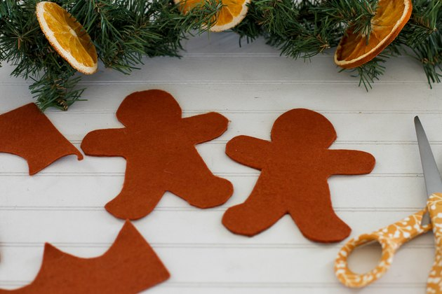 Cut out two gingerbread men from felt