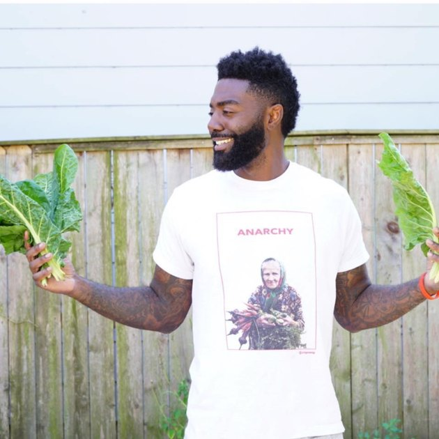 Timothy posing with vegetables