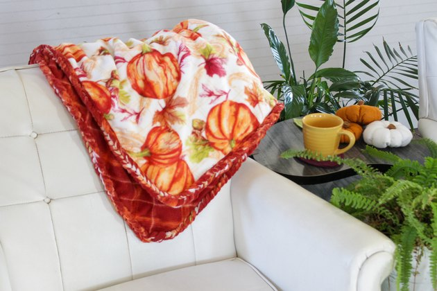 This soft and delicate DIY throw is just right for snuggling up on the couch or or adding a touch of warmth to your bed.