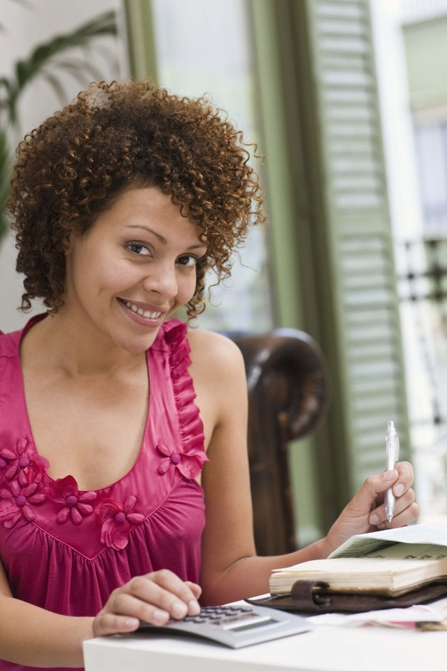 Smiling woman with paperwork