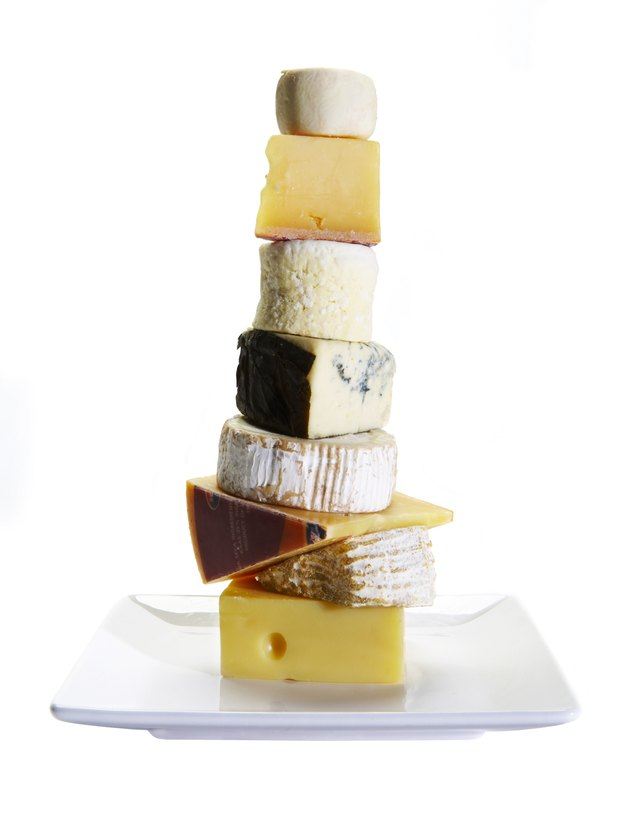 Cheese stacked on white background