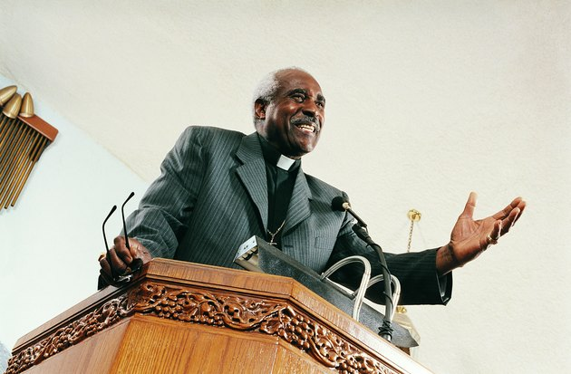Low Angle View of a Priest Preaching From a Church Pulpit During a Service