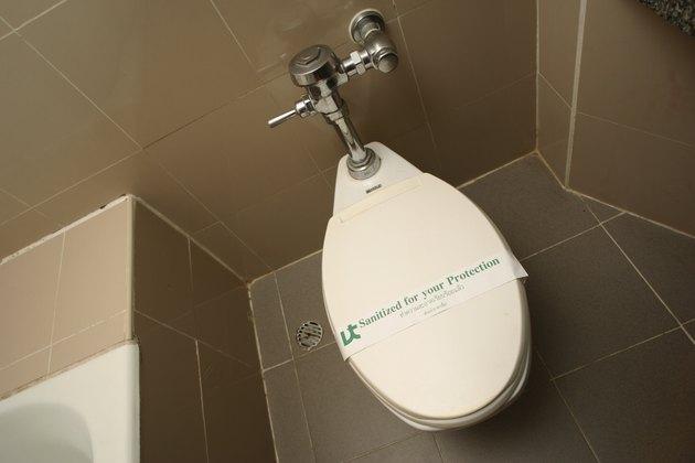 Clean toilet in bathroom
