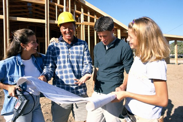 Family looking at blueprints
