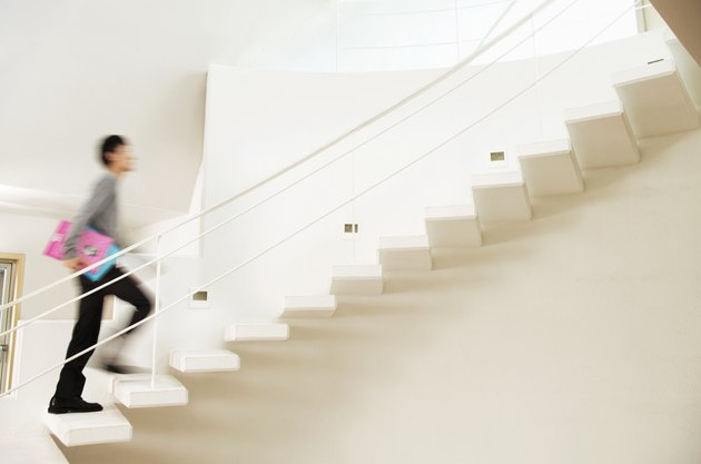 Blurred Motion Shot of a Man Ascending a Stairway in a Modern Home