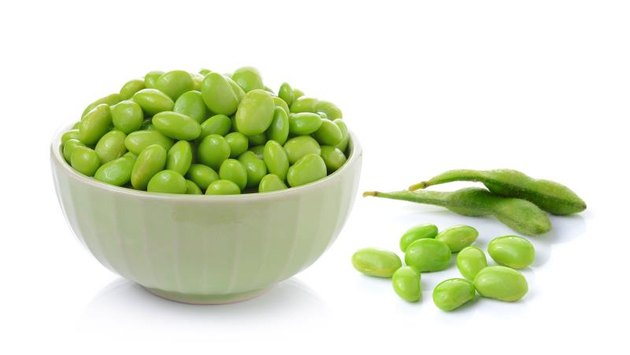 Edamame soy beans in  bowls on white background