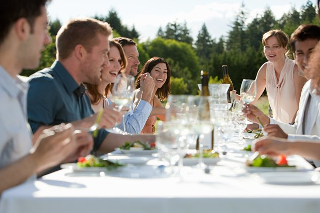 People enjoying outdoor dinner party