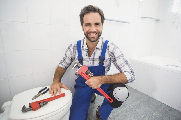 Plumber smiling at the camera