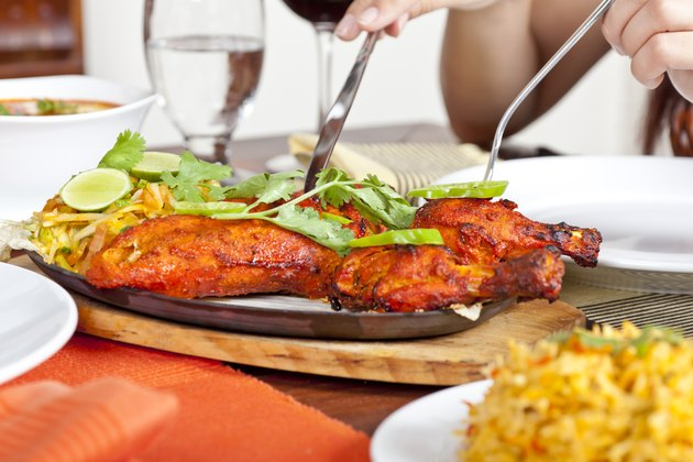 Eating Indian Food Chicken Tandoori