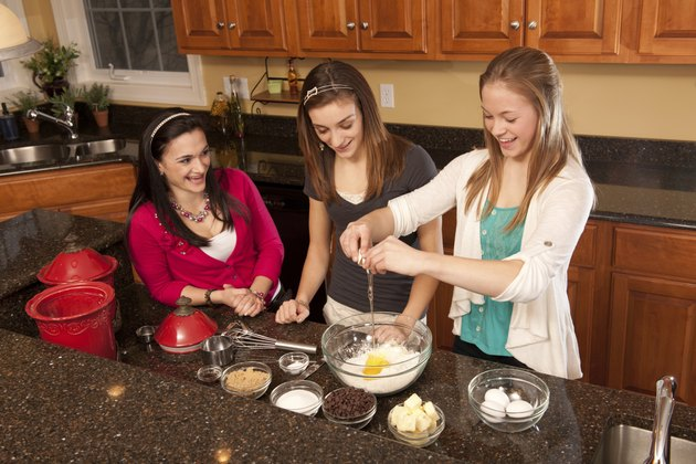 Teens baking chocolate chip cookies (series)