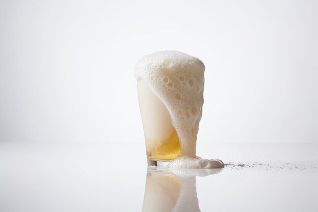 Overflowing glass of beer