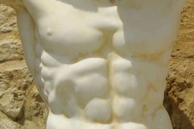 Chiseled abdomen on marble statue
