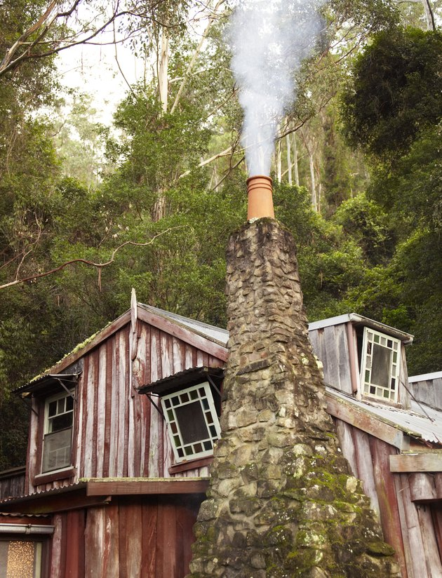 Country home with smoking chimney pot