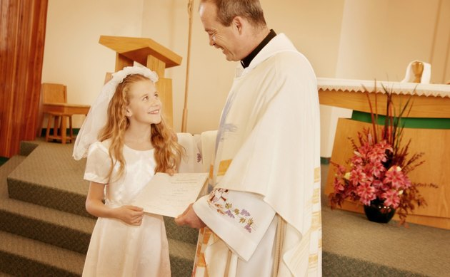 Child receives certificate from Priest
