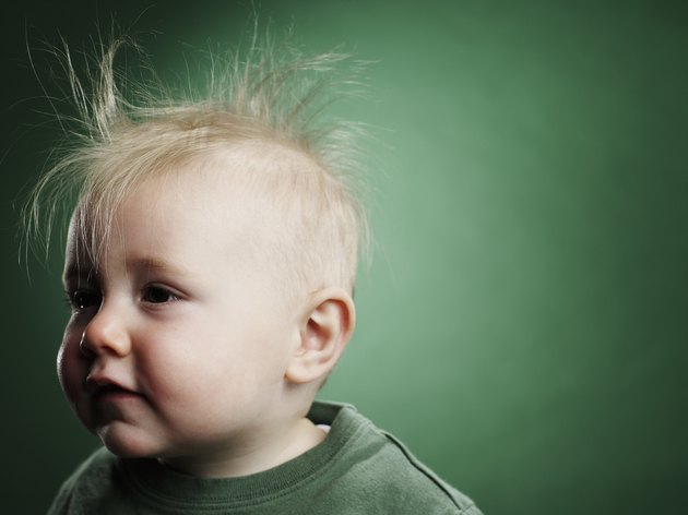 One year old boy with hair sticking up.