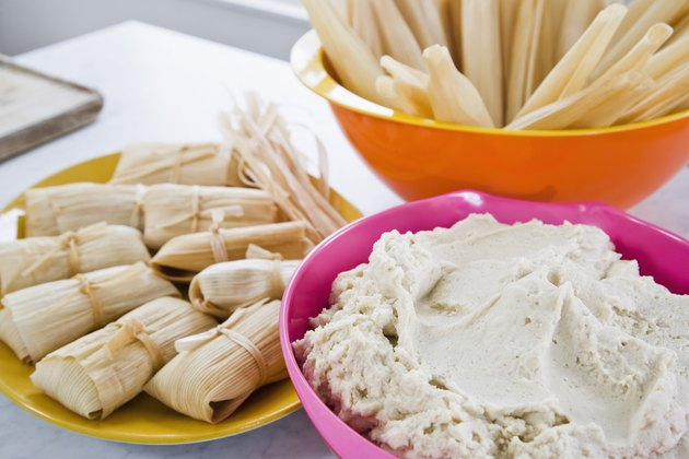 Tamales, corn husks, and masa