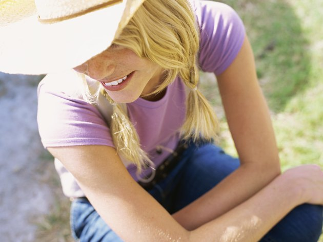 High angle view of a young woman wearing a cowboy hat