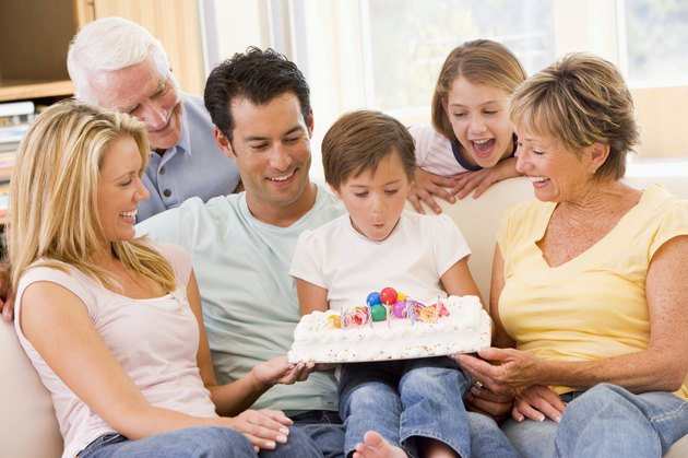 Family in living room with birthday cake
