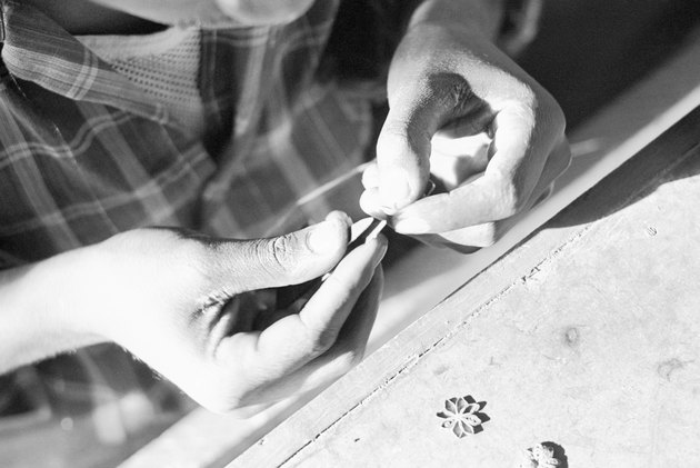 Person making jewelry