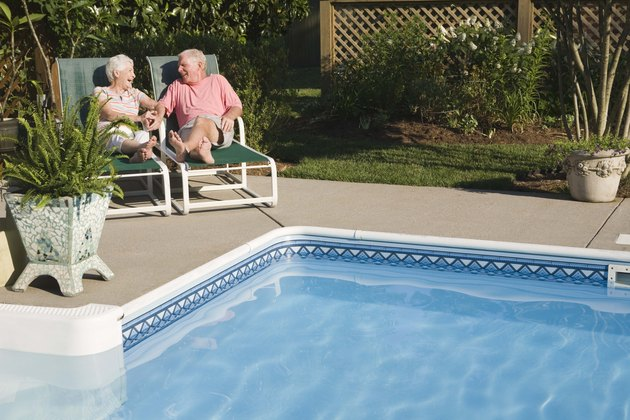 Couple sitting poolside