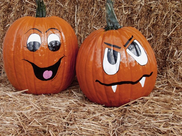 Faces painted on two pumpkins