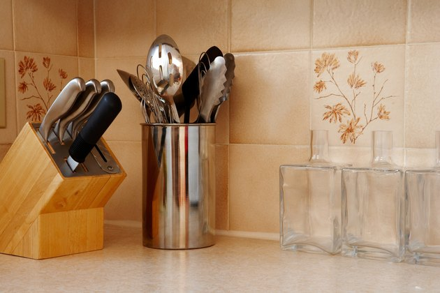 Utensils on kitchen countertop