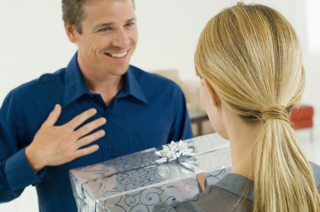 Woman giving gift to man