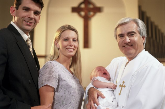 Close-up of parents with their son at a baptism
