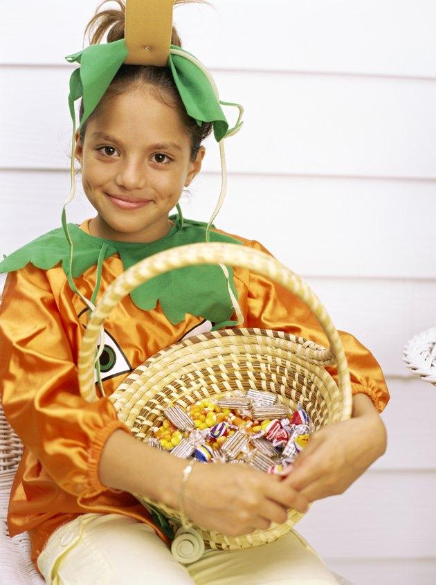 Young girl costumed as a pumpkin