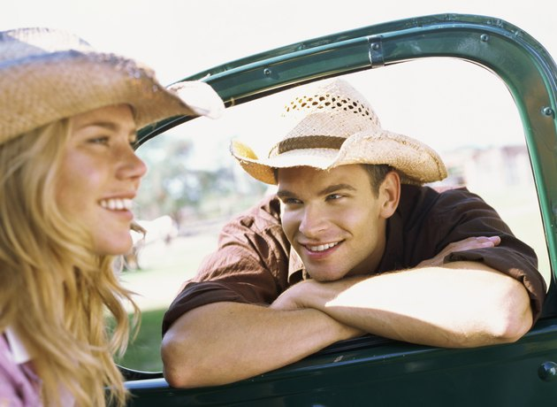 Young man looking at a Young woman in a car