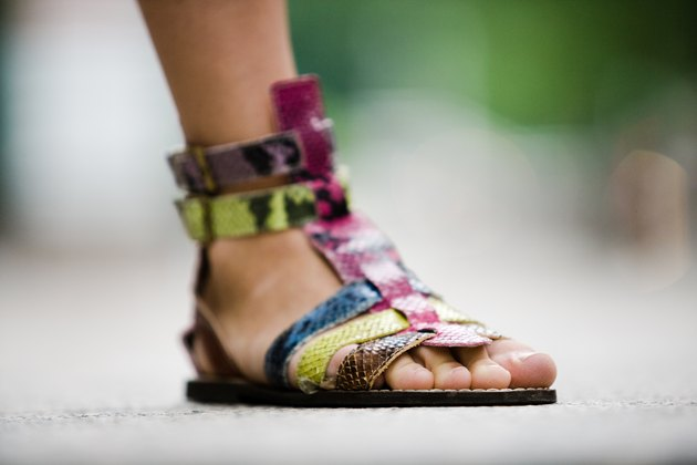 Close-up of stylish sandal on woman's foot